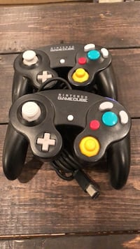 Two gamecube controller's both in black both in good condition Surrey, V3Z 2N6