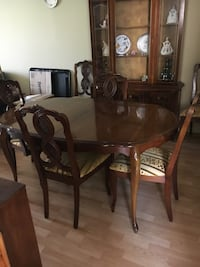 oval brown wooden table with chairs Port Hope, L1A 1C4