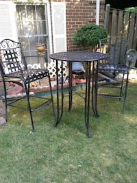 round black metal patio table with four chairs Alexandria, 22315