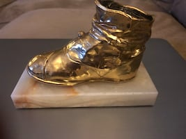 Baby items, a Gold Plated Shoe on marble