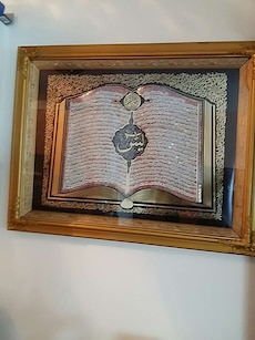 Calligraphy book with brown wooden frame