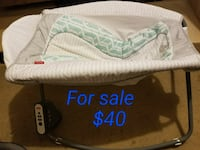 white and black Fisher-Price bouncer Atwater