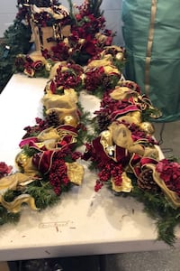 Indoor railing or fireplace mantle professionally decorated garland.  Toms River, 08753