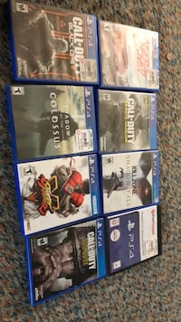 six assorted PS4 game cases Reading, 19604
