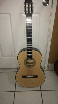 brown and black acoustic guitar Greenfield, 93927
