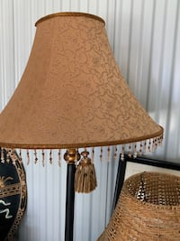 Two tall lamps with tassles