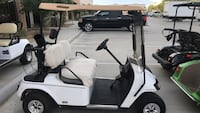 white and black golf cart