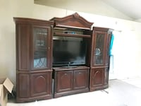 brown wooden TV hutch with flat screen television Palm Bay, 32907
