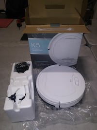 white K5 robotic vacuum cleaner with box