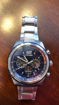 Round silver and black chronograph watch with silver link bracelet
