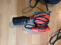 red and black corded power tool Ocean, 07712