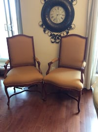two brown wooden framed brown leather padded armchairs Côte-Saint-Luc, H4W