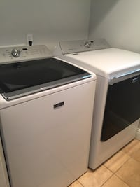 white Maytag clothes washer and dryer set