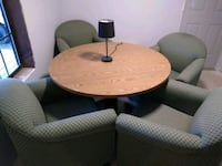 round brown wooden table with four chairs 518 mi