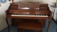 brown wooden framed upright piano Plainview, 11803