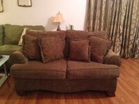 brown fabric 2-seat sofa with throw pillows DeLand