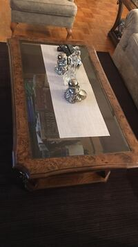 brown wooden framed glass top coffee table Toronto, M3C 3A3