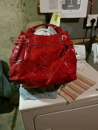 This red Jessica purse is in mint condition  Calgary, T2K 5C4
