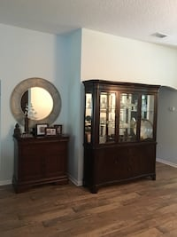 brown wooden framed glass display cabinet Miami, 33127