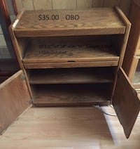 TV stand with a slide out and 2 doors Lancaster, 93534