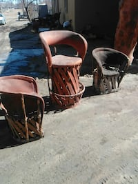 three brown and black armchairs