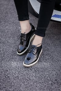 black-and-white patent leather shoes