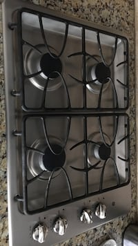 Grey and black stainless steel 4-burner gas stove Warrenton, 20187