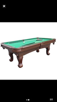 Pool table with cue rack and accessories