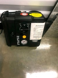 black and red portable generator 49 km