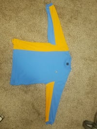 blue and yellow Nike long sleeve shirt