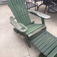 Muskoka chairs with attached foot rest