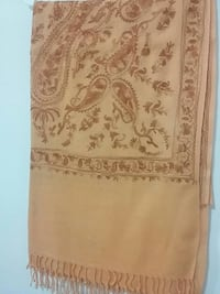 brown and beige floral area rug