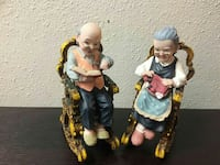 two grandfather and grandmother ceramic figurines