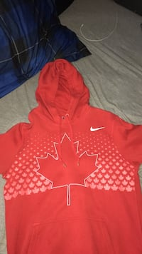 red and white Nike pull over hoodie