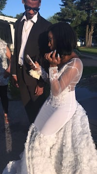 last years prom dress it was custom made for $800 the lowest I will go is 500. Contact me for a all white dress  Florissant, 63031