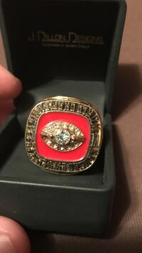 Gold-colored and red championship ring Overland Park