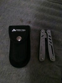 black and gray pocket knife with case Farmington, 26571