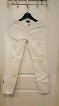 Distressed white women's jeans