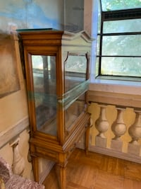 Breakfront cabinet with legs.  Glass shelves for displaying your favorite collectibles.  Very old in excellent condition  Philadelphia