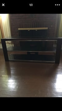 Black wooden framed glass top tv stand North Brunswick, 08902