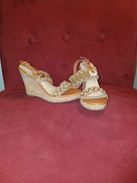 pair of women's brown-and-white open-toe sling-back wedge heels Columbus, 31820
