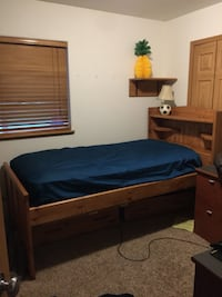 Brown wooden bed frame Wasilla