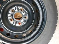 two gray bullet hole vehicle wheels and tires 560 km