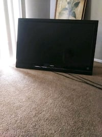 black flat screen TV with remote Jacksonville