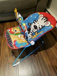 baby's blue and green bouncer Laval, H7P 5M7