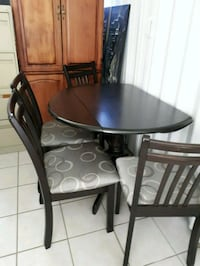 round brown wooden table with four chairs dining set Maple Ridge, V2X 5M5