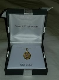 Gold necklace with gold Angel pendant.