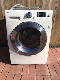 white front-load clothes washer 42 km