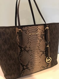 Micheal Kors Travel Tote w/ snake skin center. Never used 320$ tags on East Islip, 11730