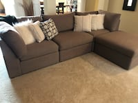 gray fabric sectional sofa with throw pillows Stallings, 28104
